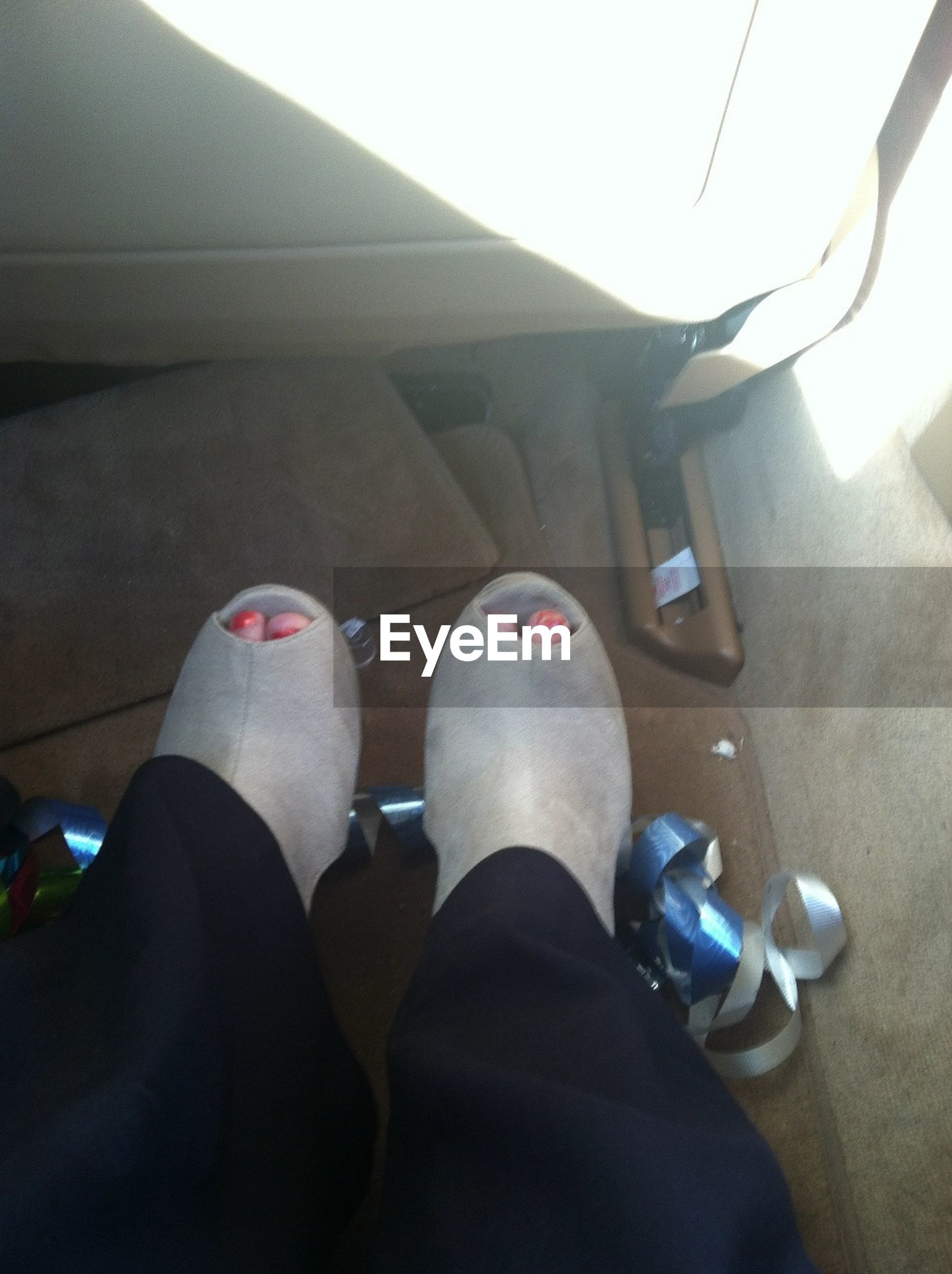 low section, person, indoors, personal perspective, lifestyles, shoe, leisure activity, human foot, sitting, relaxation, men, vehicle interior, part of, footwear, high angle view, transportation