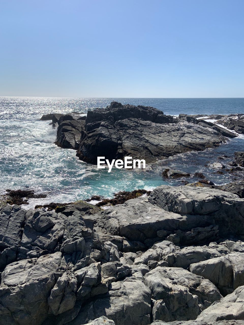 sea, rock, water, rock - object, sky, solid, beauty in nature, horizon, clear sky, land, horizon over water, beach, scenics - nature, nature, no people, day, tranquility, motion, tranquil scene, outdoors, rocky coastline