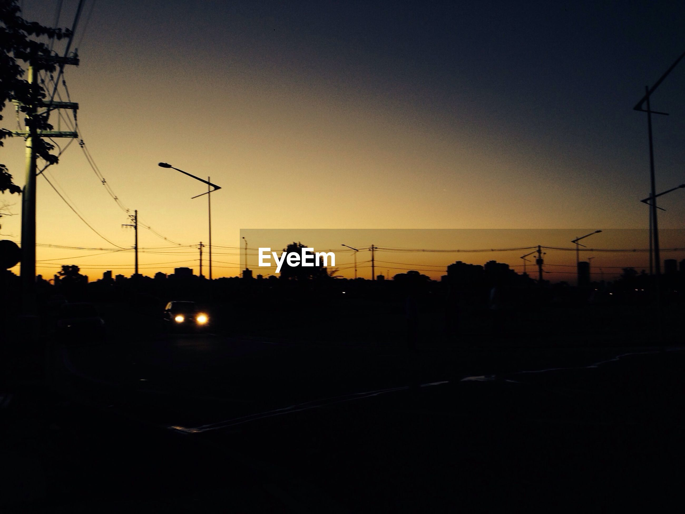 power line, sunset, electricity pylon, silhouette, electricity, power supply, cable, connection, fuel and power generation, clear sky, power cable, sky, street light, technology, orange color, dusk, tree, transportation, copy space, dark