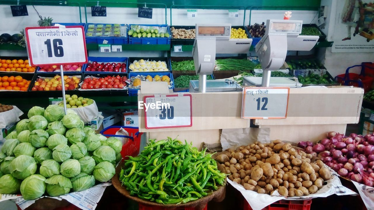 price tag, food, variation, retail, choice, market, for sale, vegetable, food and drink, market stall, freshness, communication, no people, arrangement, healthy eating, large group of objects, fruit, day, business, outdoors