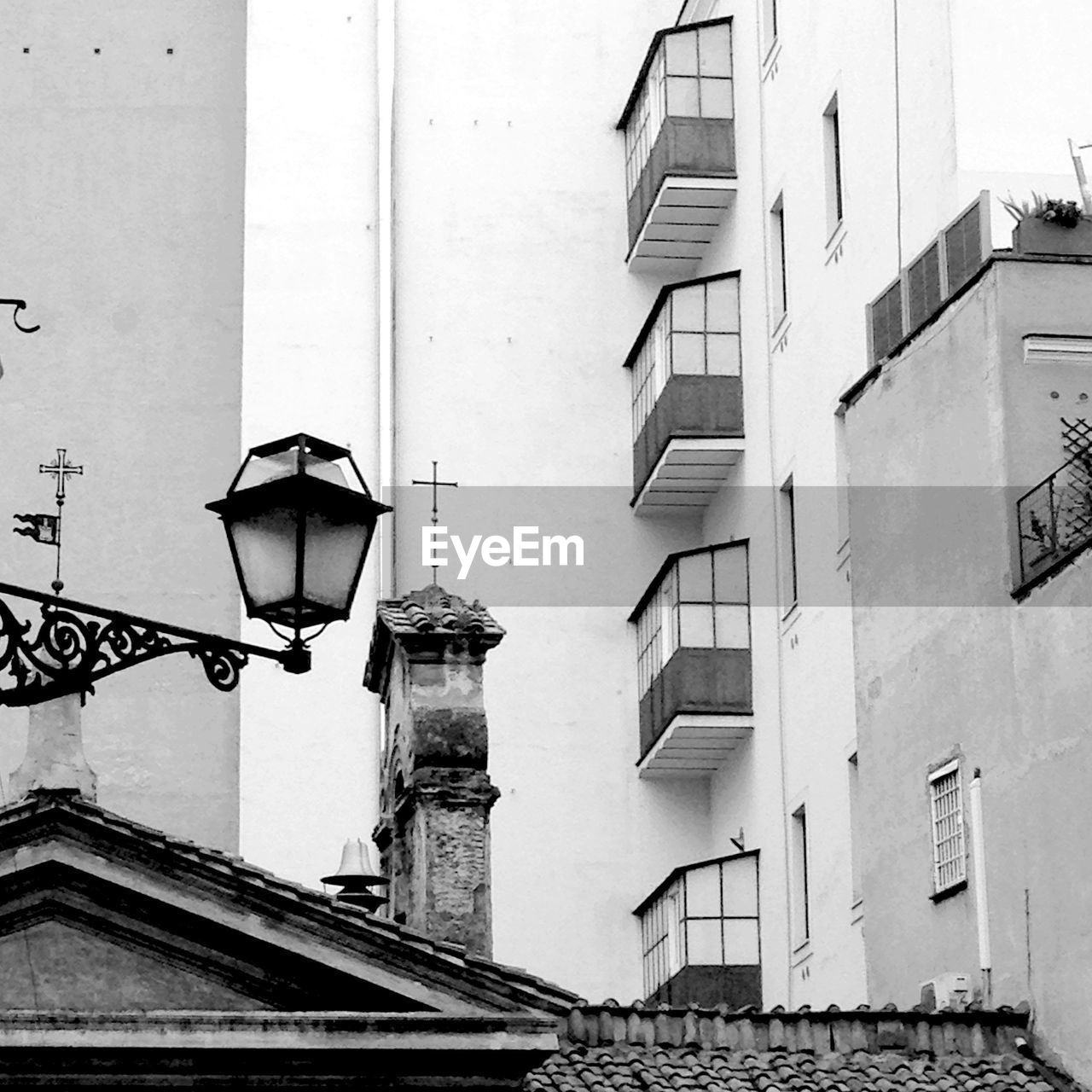 building exterior, architecture, lighting equipment, built structure, street light, street lamp, low angle view, no people, outdoors, gas light, day, city, sky