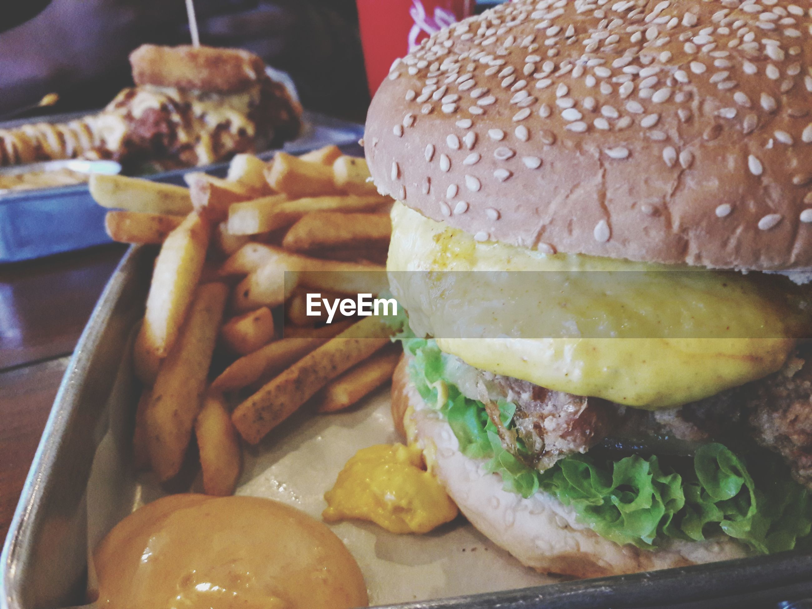 burger, hamburger, food and drink, food, unhealthy eating, french fries, bun, indoors, ready-to-eat, fast food, freshness, meat, close-up, plate, lettuce, no people, deep fried, day