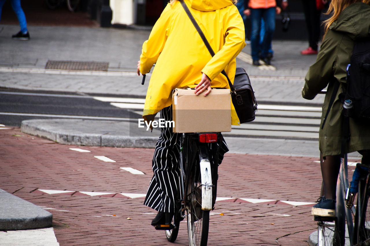 Low Section Of Women Riding Bicycle On Street