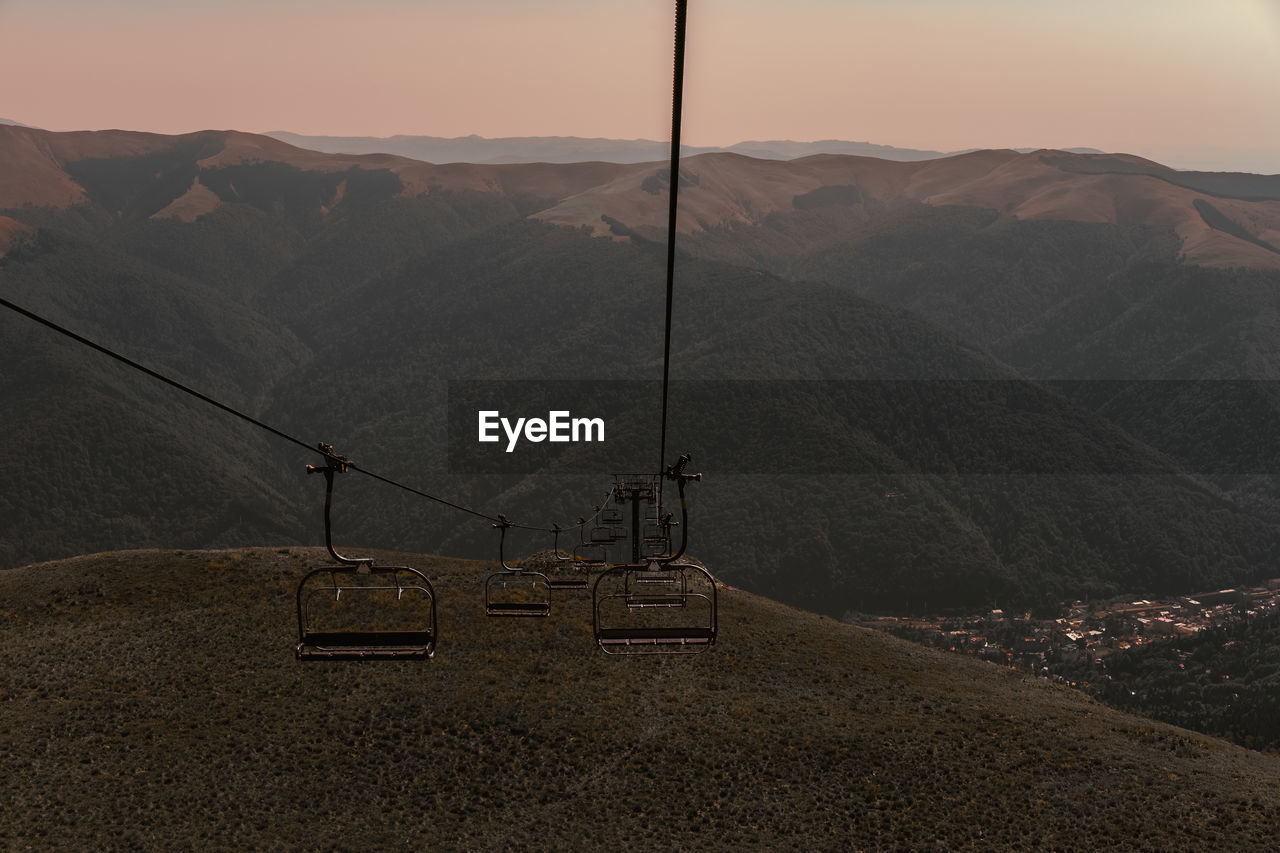 Overhead Cable Car Against Mountains During Sunset