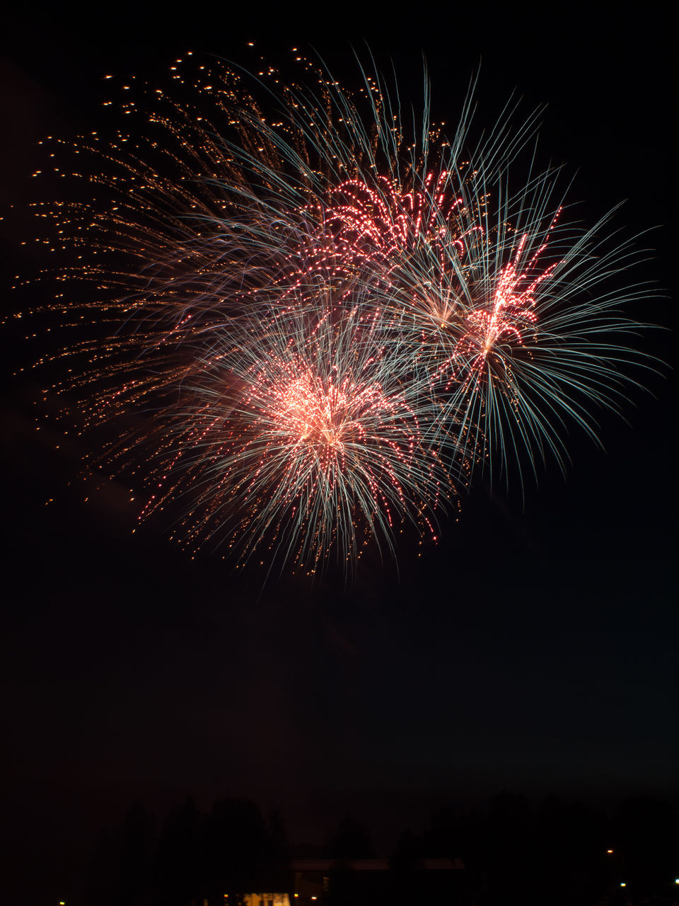 night, illuminated, firework, motion, celebration, firework display, arts culture and entertainment, event, sky, exploding, low angle view, nature, no people, glowing, long exposure, firework - man made object, blurred motion, multi colored, outdoors, light, sparks, explosive