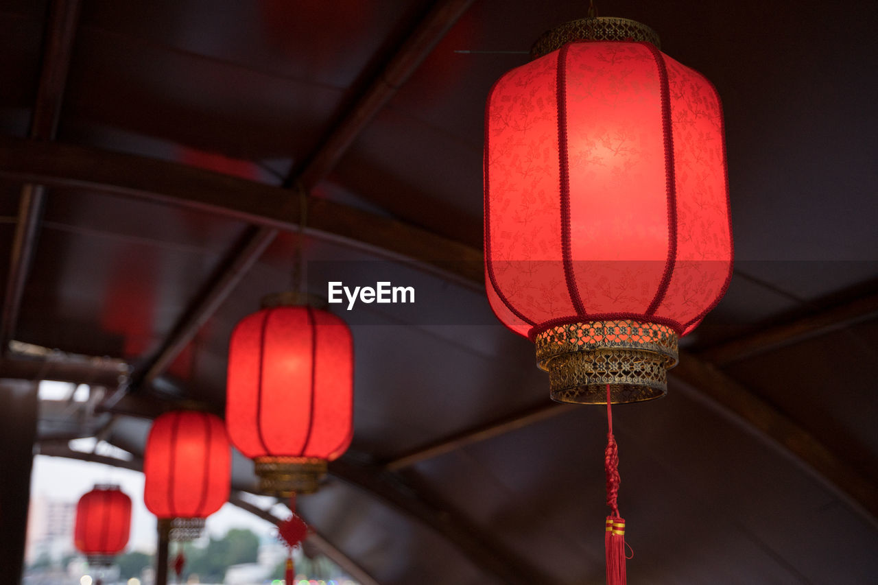 lighting equipment, red, lantern, hanging, no people, low angle view, illuminated, focus on foreground, architecture, chinese lantern, decoration, ceiling, built structure, indoors, close-up, building, electricity, light, electric lamp, chinese new year, paper lantern