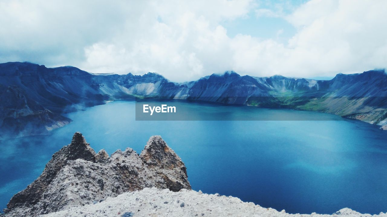 Panoramic View Of Lake And Mountains Against Sky