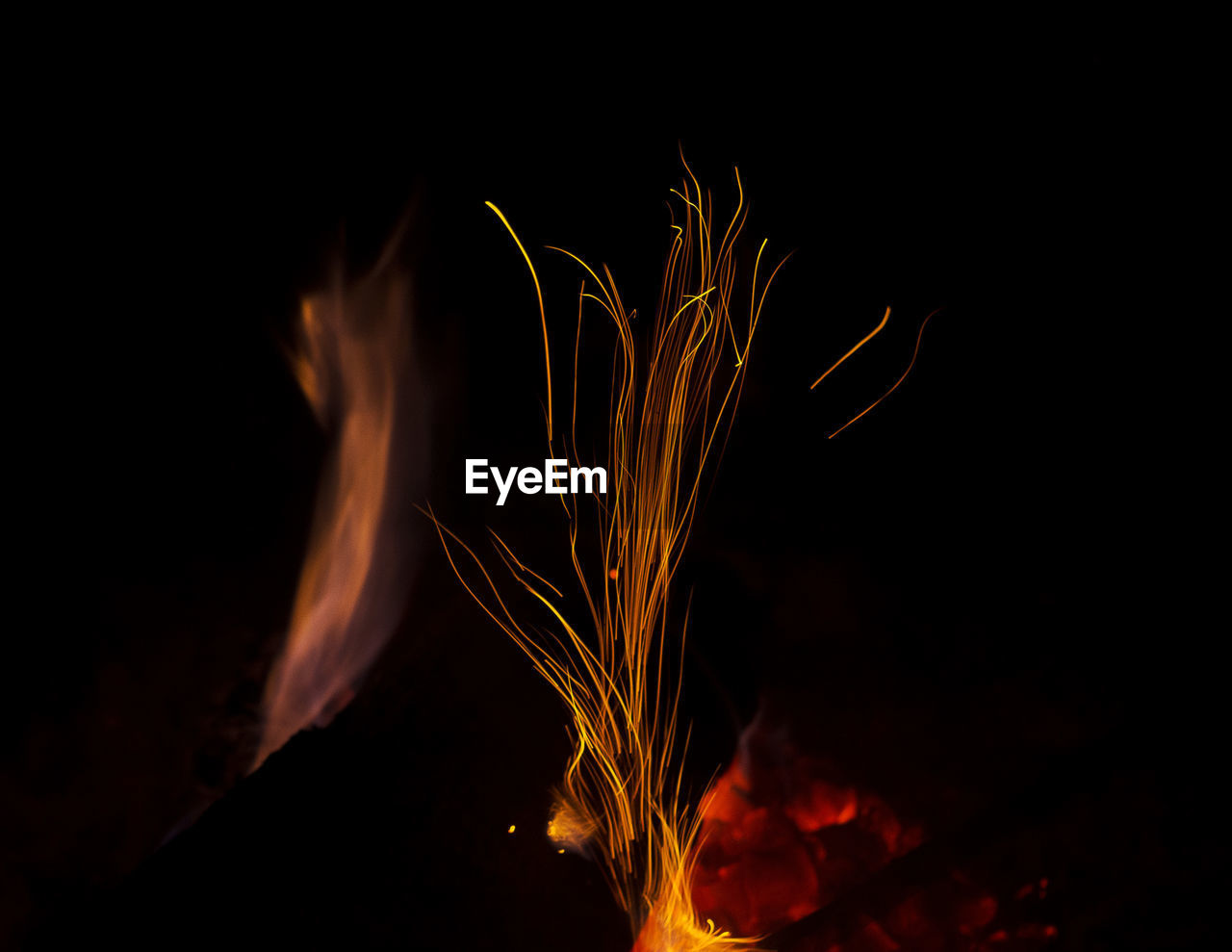 burning, night, heat - temperature, glowing, motion, flame, close-up, no people, long exposure, nature, beauty in nature, illuminated, bonfire, black background, outdoors