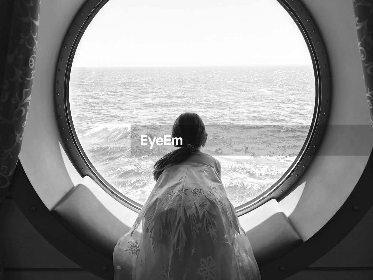 Rear View Of Girl Looking At Sea From Tourboat