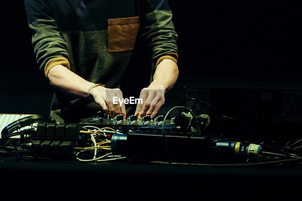 Man Mixing Music In Sound Mixer