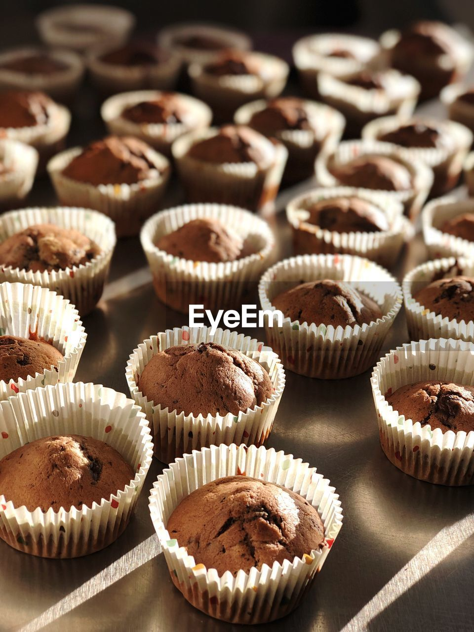 cupcake, cake, dessert, indoors, sweet food, cupcake holder, food and drink, sweet, indulgence, chocolate, temptation, no people, still life, freshness, food, baked, in a row, close-up, unhealthy eating, repetition, muffin