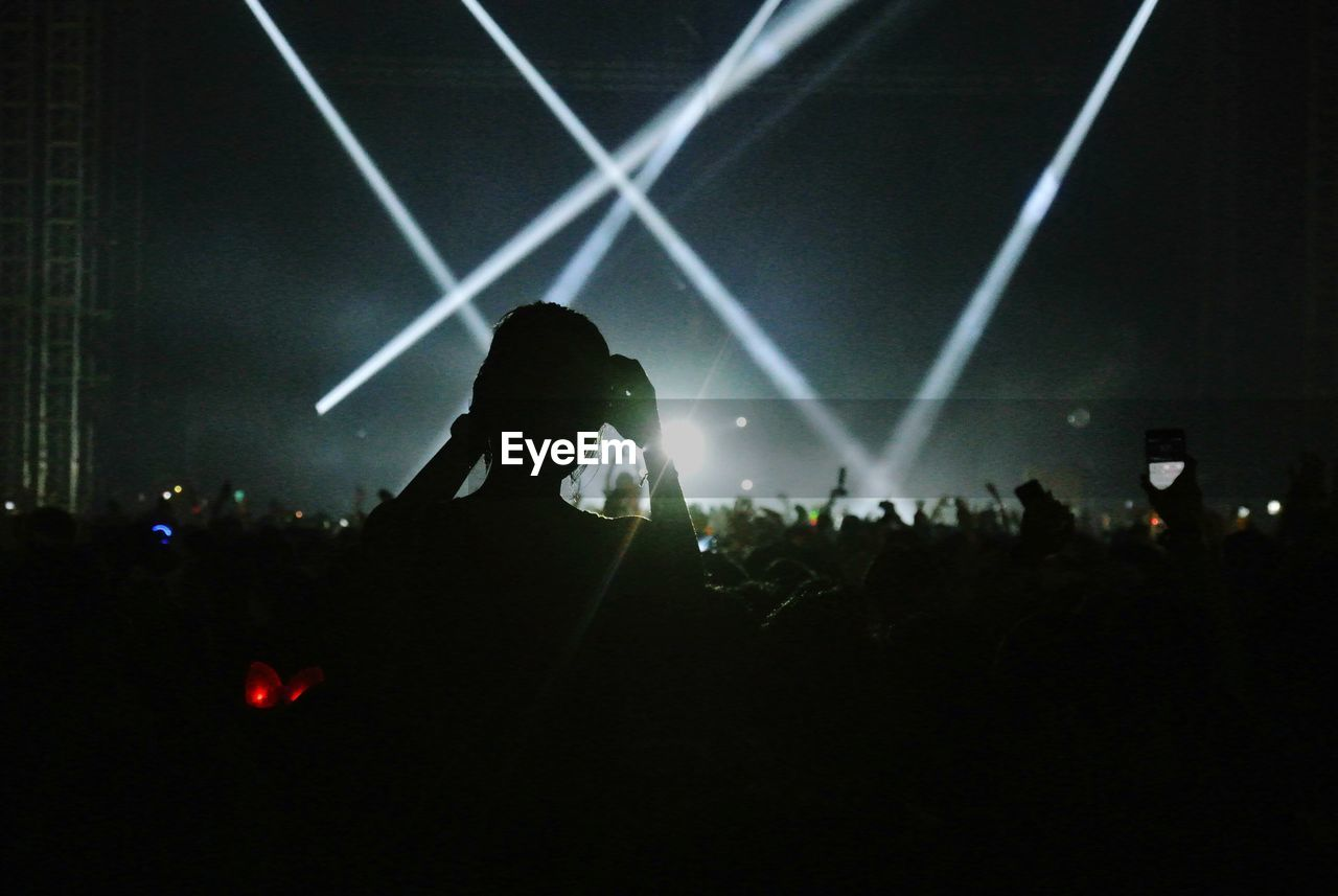 Rear View Of Woman Looking At Crowd During Music Concert