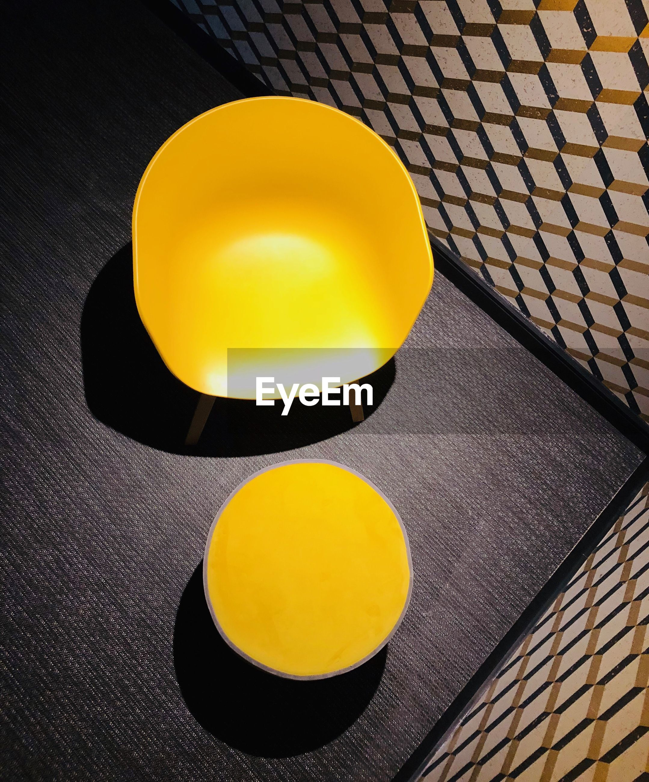 High angle view of yellow bowls