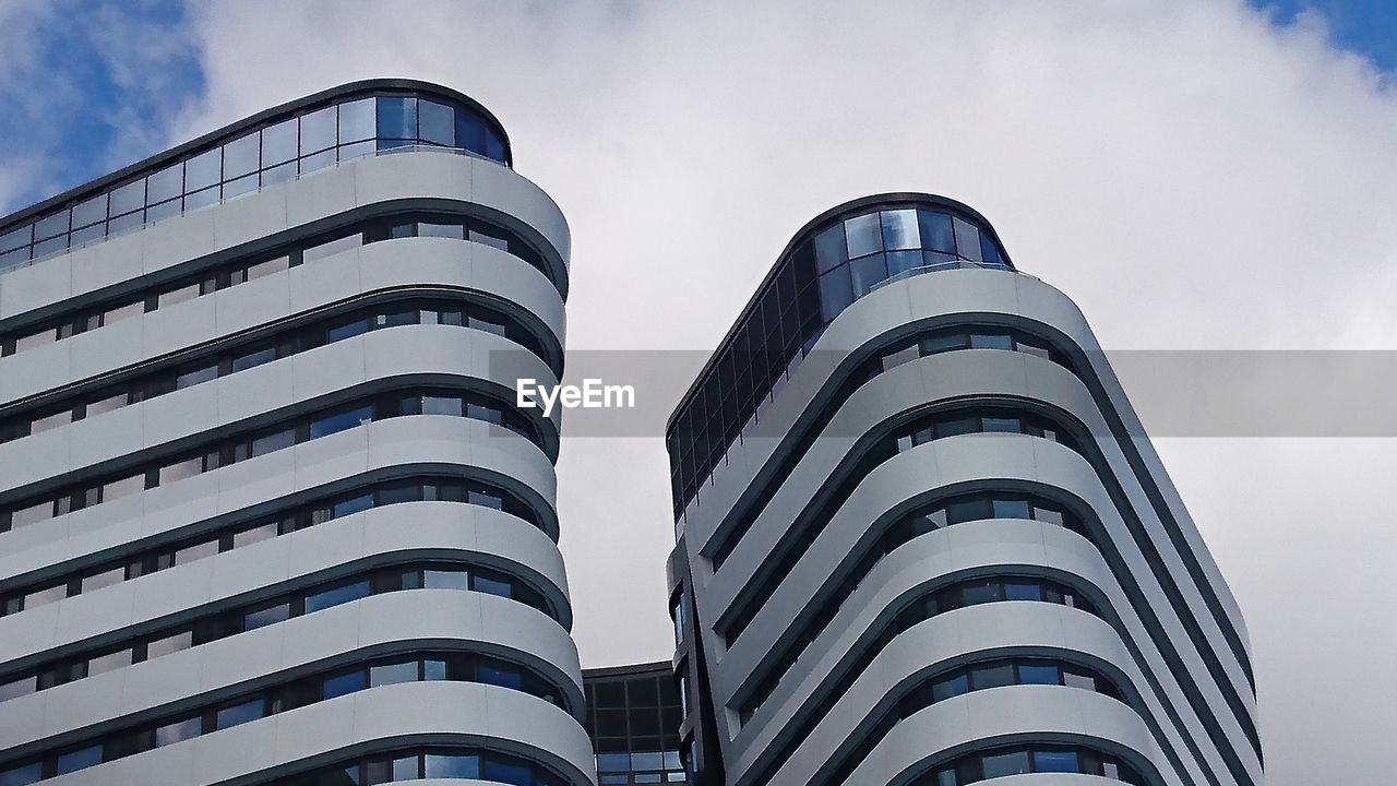 architecture, built structure, low angle view, building exterior, sky, day, modern, outdoors, no people, cloud - sky, city, skyscraper