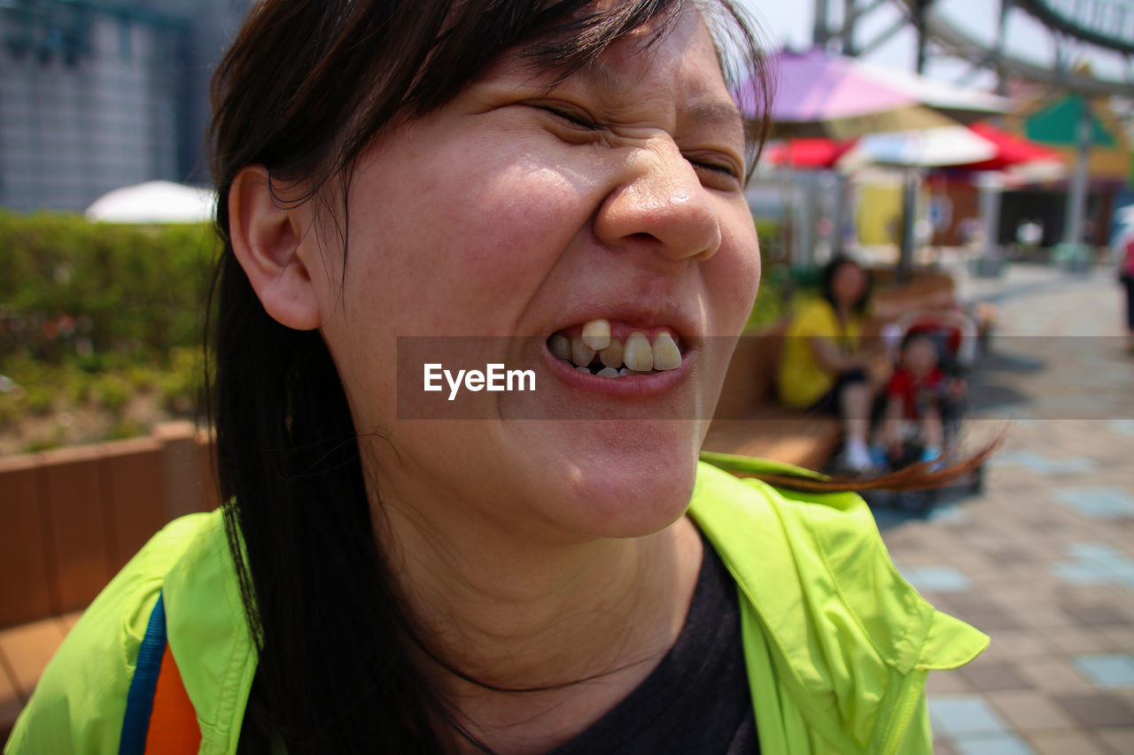 Close-Up Of Woman Making Face On Street