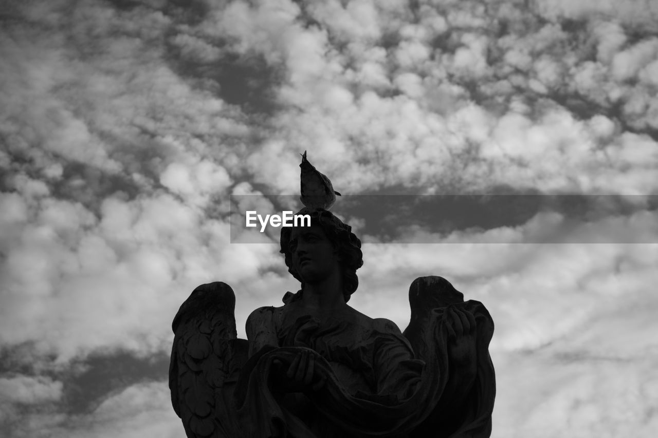 sculpture, statue, cloud - sky, art and craft, representation, human representation, sky, creativity, low angle view, no people, male likeness, day, craft, nature, spirituality, religion, belief, focus on foreground, outdoors, angel, idol