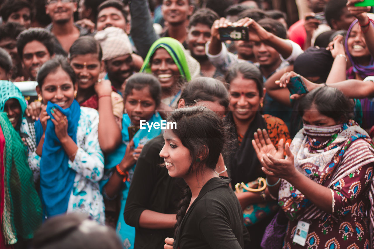 group of people, crowd, large group of people, real people, women, lifestyles, togetherness, emotion, happiness, enjoyment, leisure activity, men, celebration, adult, fun, event, young adult, standing, smiling, festival, human arm, excitement, nightlife