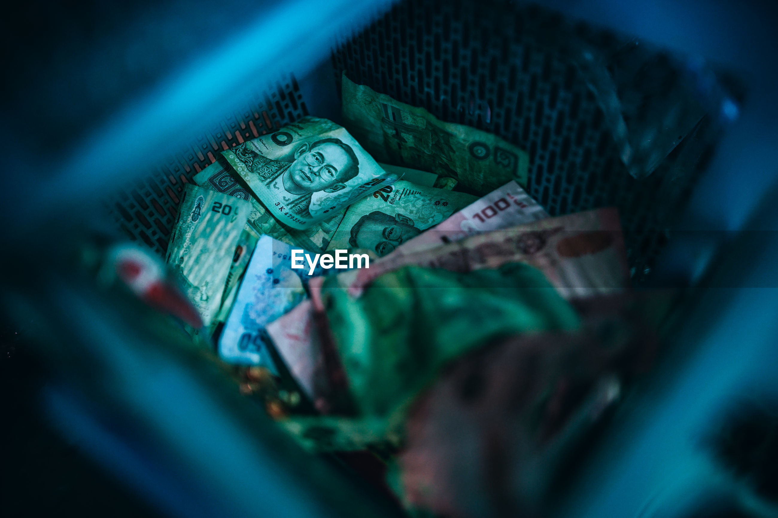 Close-up of currency in basket