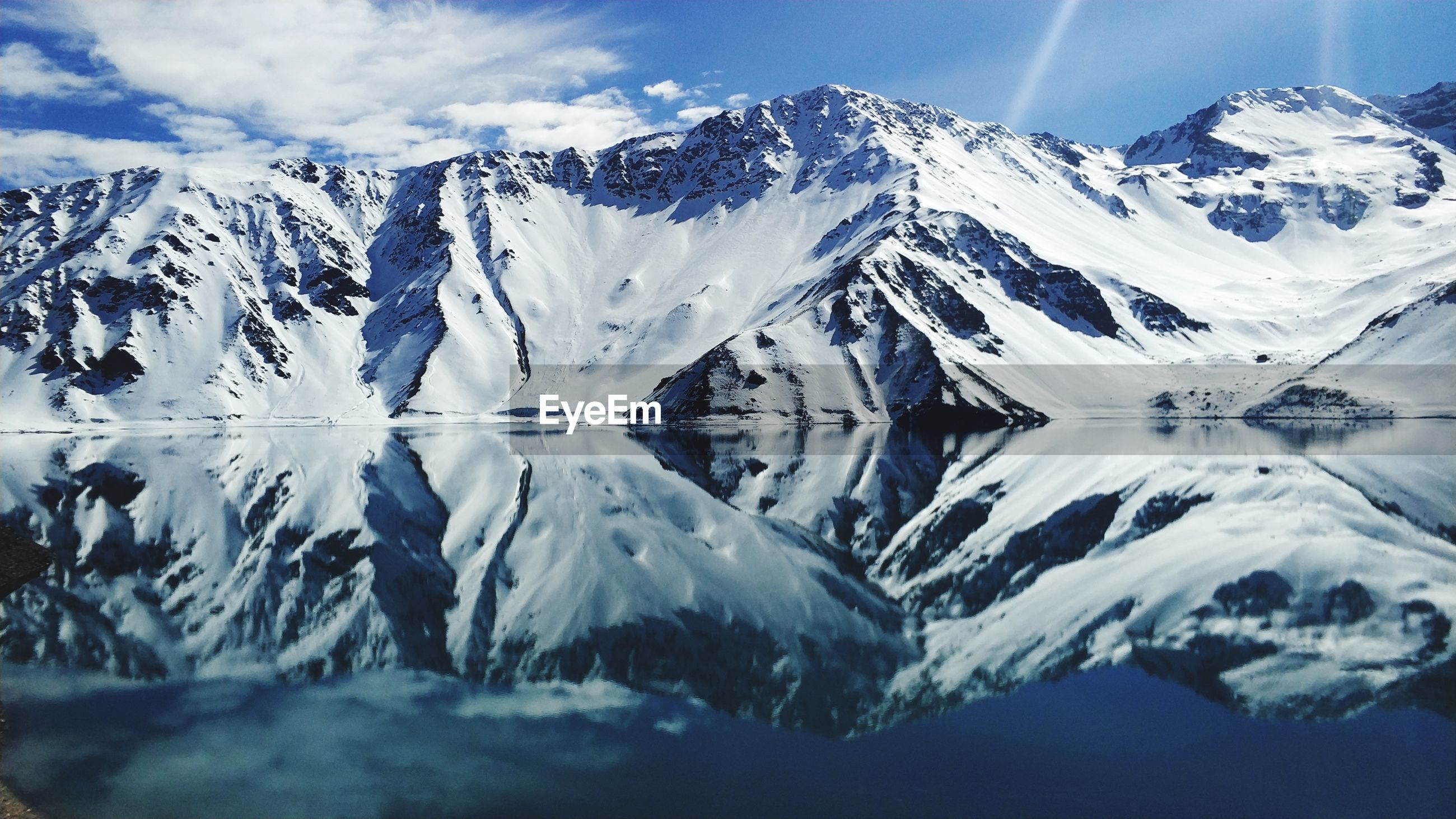 Reflection of snowcapped mountains in lake