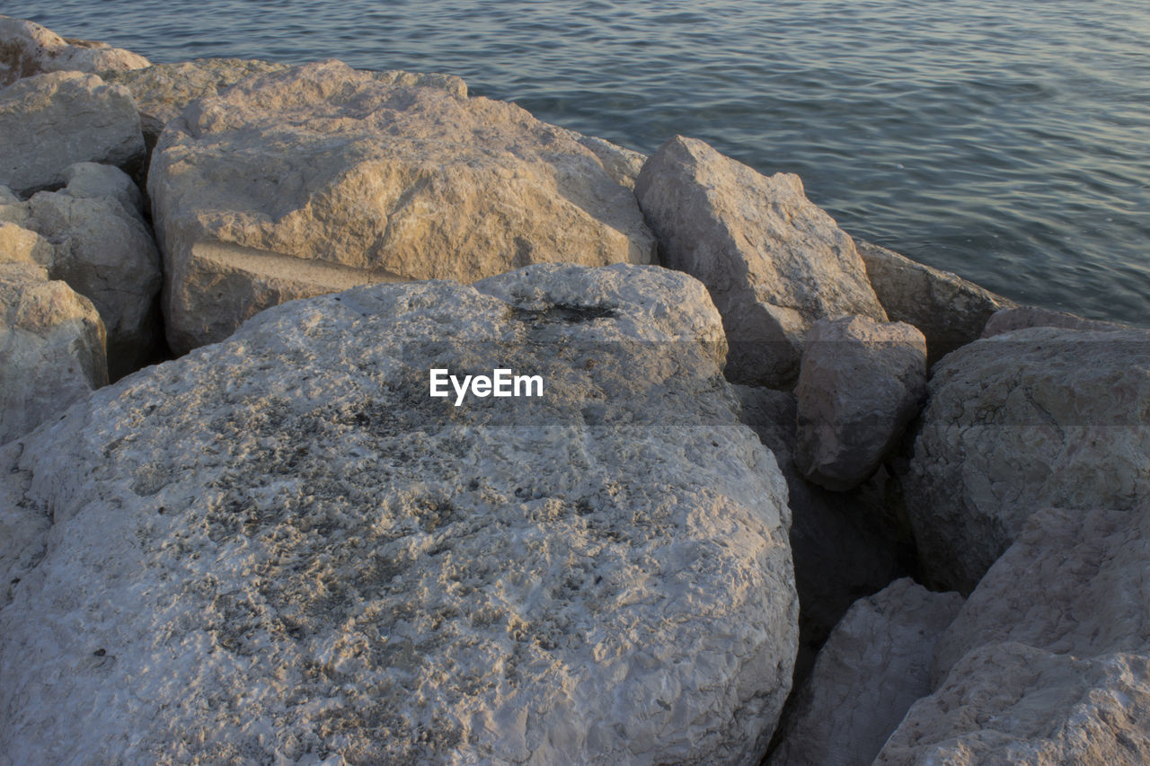 rock - object, water, sea, nature, no people, day, outdoors, beach, beauty in nature, close-up