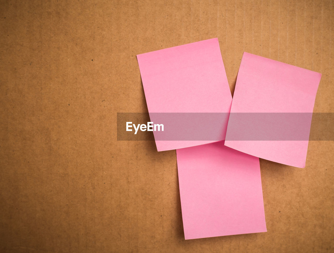 Close-up of blank sticky notes on cardboard box