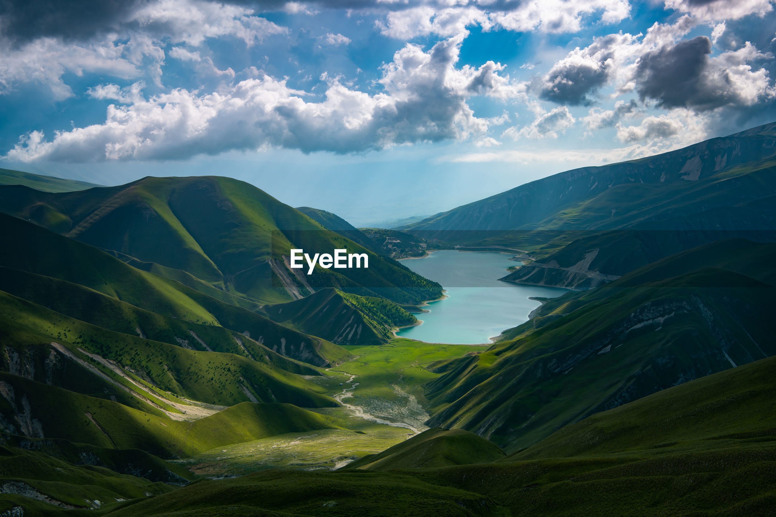 Lake kezenoy am in chechnya. scenic view of mountains against sky.