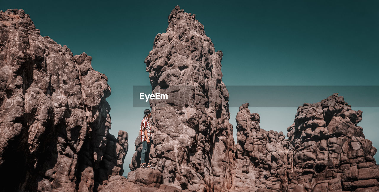 rock formation, rock, sky, rock - object, low angle view, solid, no people, clear sky, nature, geology, day, physical geography, beauty in nature, tranquility, outdoors, tranquil scene, mountain, non-urban scene, scenics - nature, blue, eroded, formation, arid climate, mountain peak