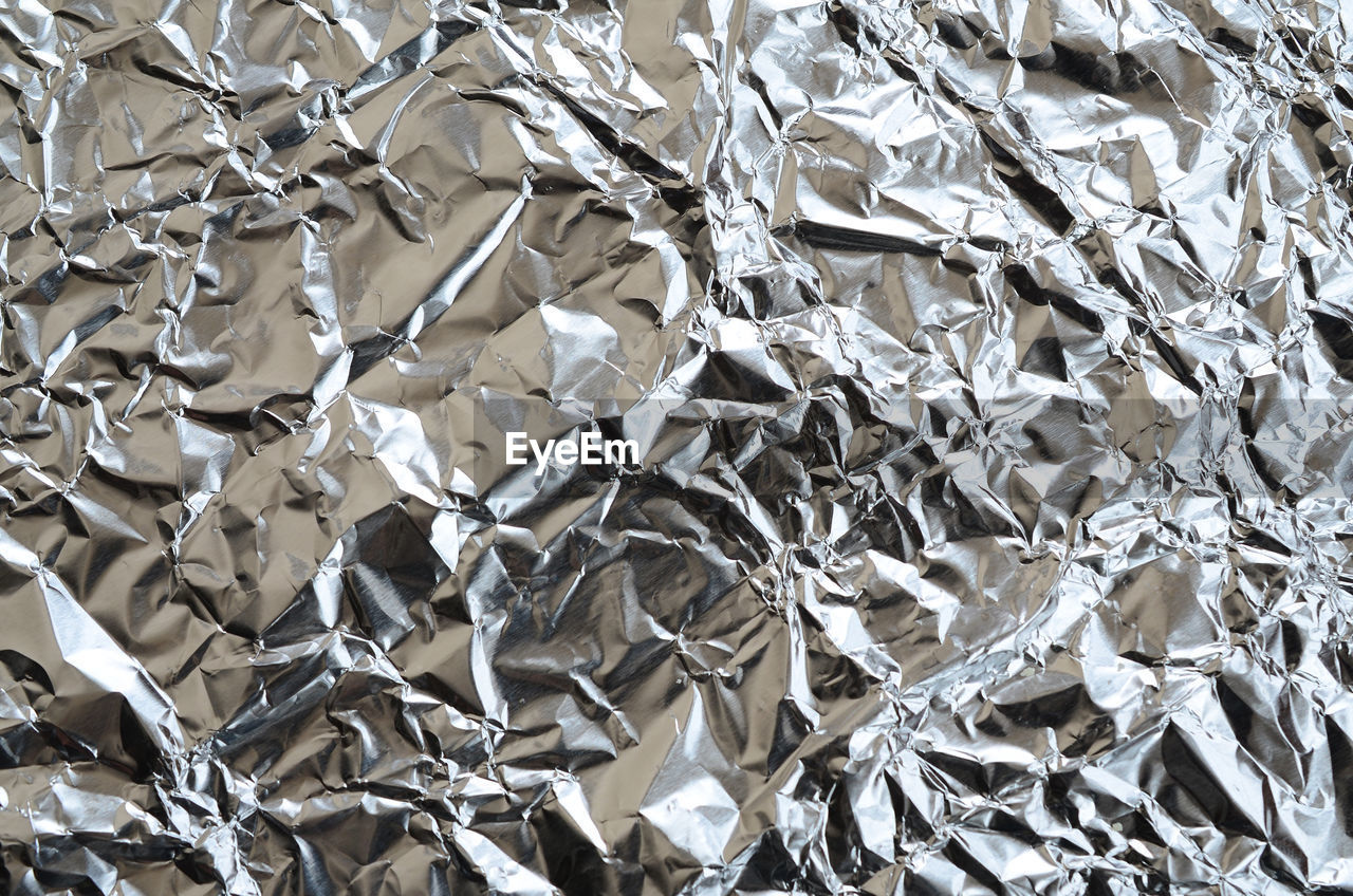 full frame, backgrounds, pattern, silver colored, no people, crumpled, silver - metal, textured, metal, aluminum, damaged, foil - material, close-up, shiny, paper, abstract, crushed, wrinkled, indoors, abstract backgrounds, luxury, textured effect
