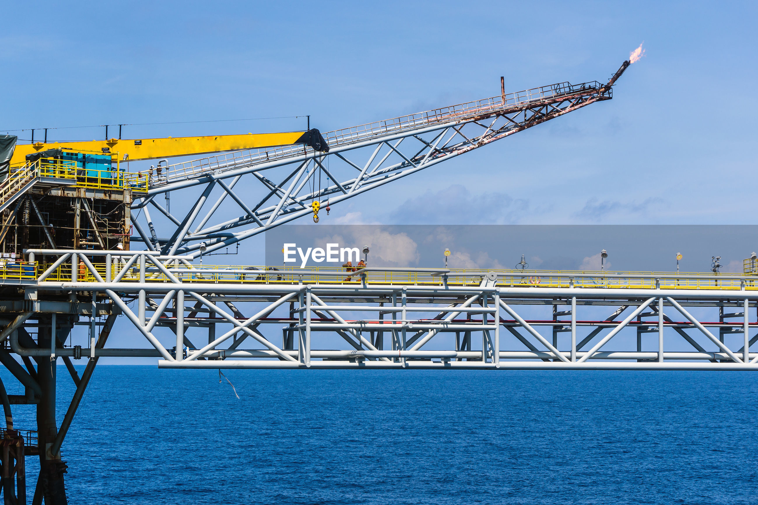 Bridge connecting between oil prodcution platforms at oil field with flare boom and crane
