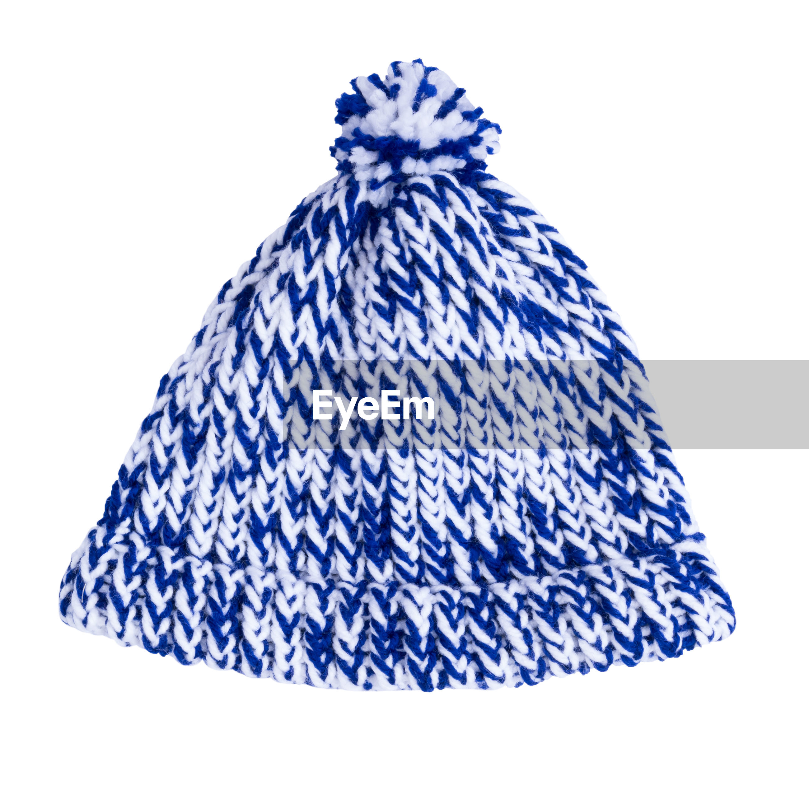 Close-up of knit hat against white background