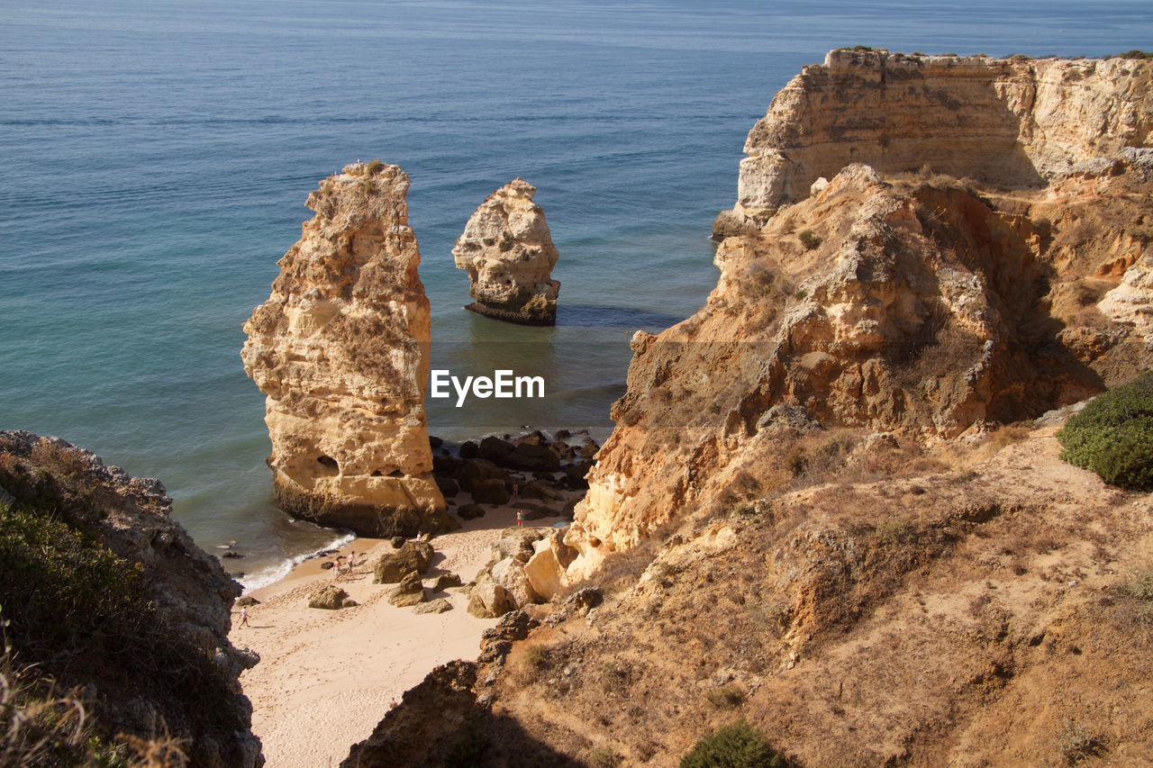 water, rock, sea, rock - object, solid, rock formation, land, beach, beauty in nature, tranquility, nature, scenics - nature, tranquil scene, no people, day, high angle view, cliff, outdoors, physical geography, stack rock, eroded