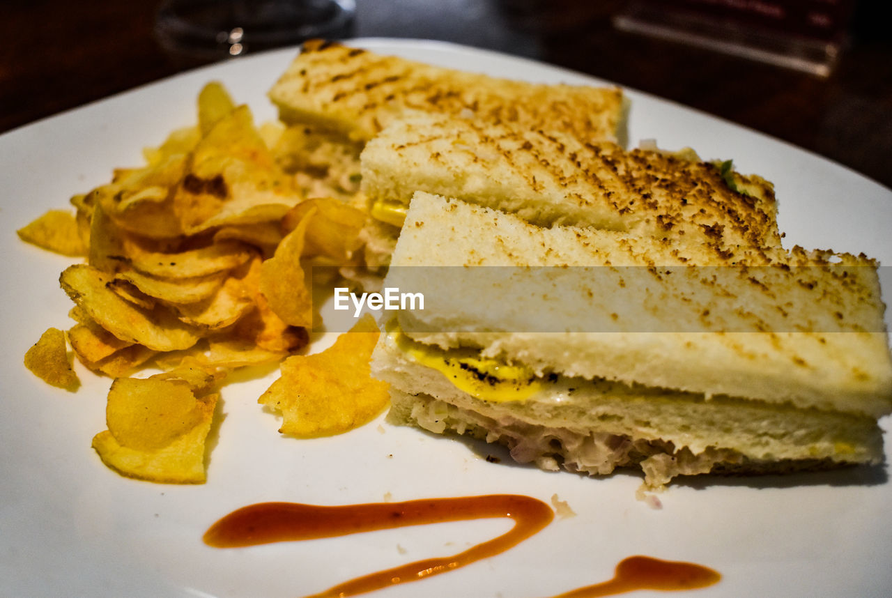plate, food, ready-to-eat, food and drink, bread, freshness, indoors, close-up, still life, meal, serving size, no people, indulgence, unhealthy eating, snack, breakfast, yellow, table, sandwich, egg, temptation