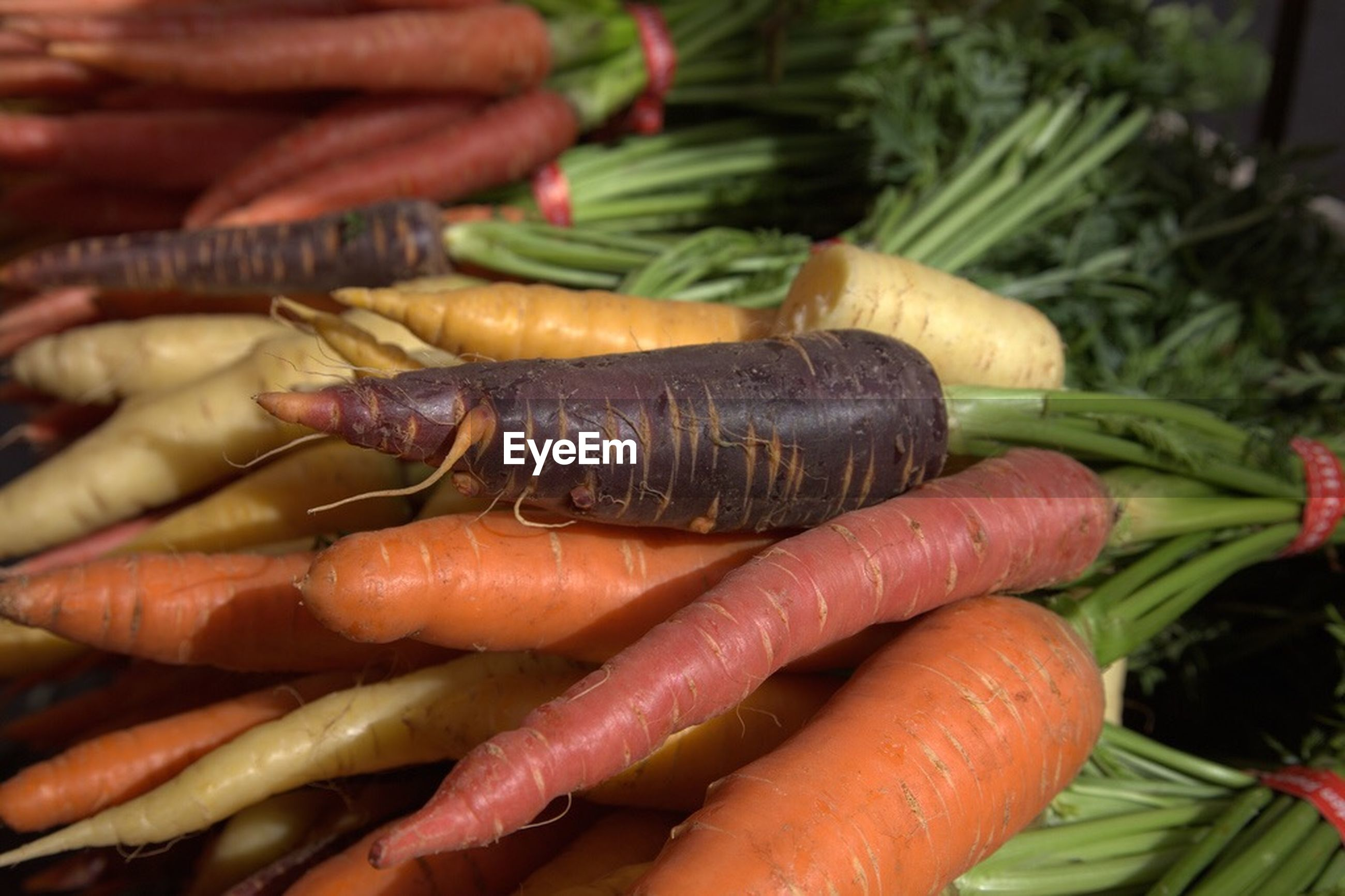 Close-up of carrots displayed at market stall