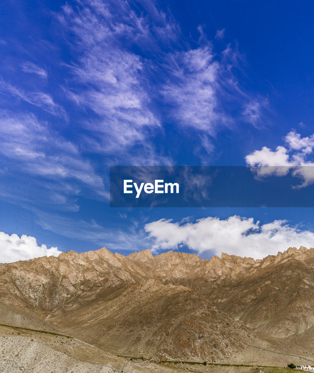 sky, cloud - sky, scenics - nature, beauty in nature, blue, tranquil scene, tranquility, mountain, non-urban scene, landscape, day, nature, environment, no people, physical geography, desert, land, arid climate, rock, geology, outdoors, climate, formation