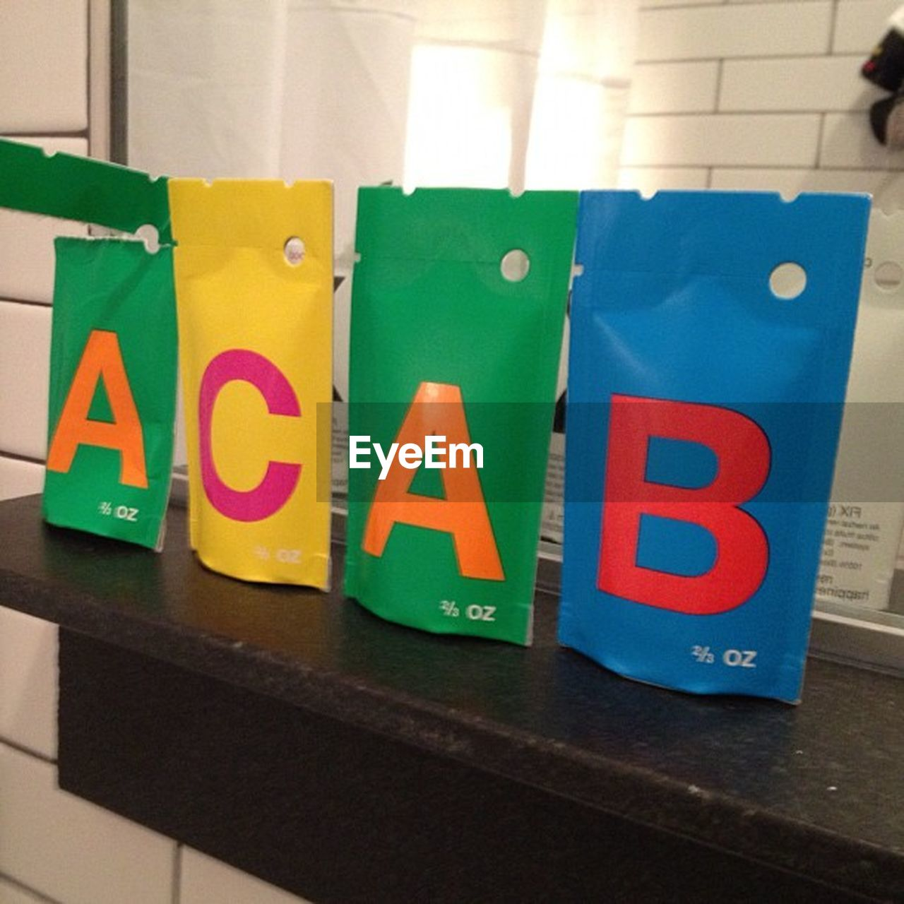 text, multi colored, indoors, green color, communication, colorful, number, toy, no people, education, toy block, red, alphabet, yellow, learning, close-up, childhood, day