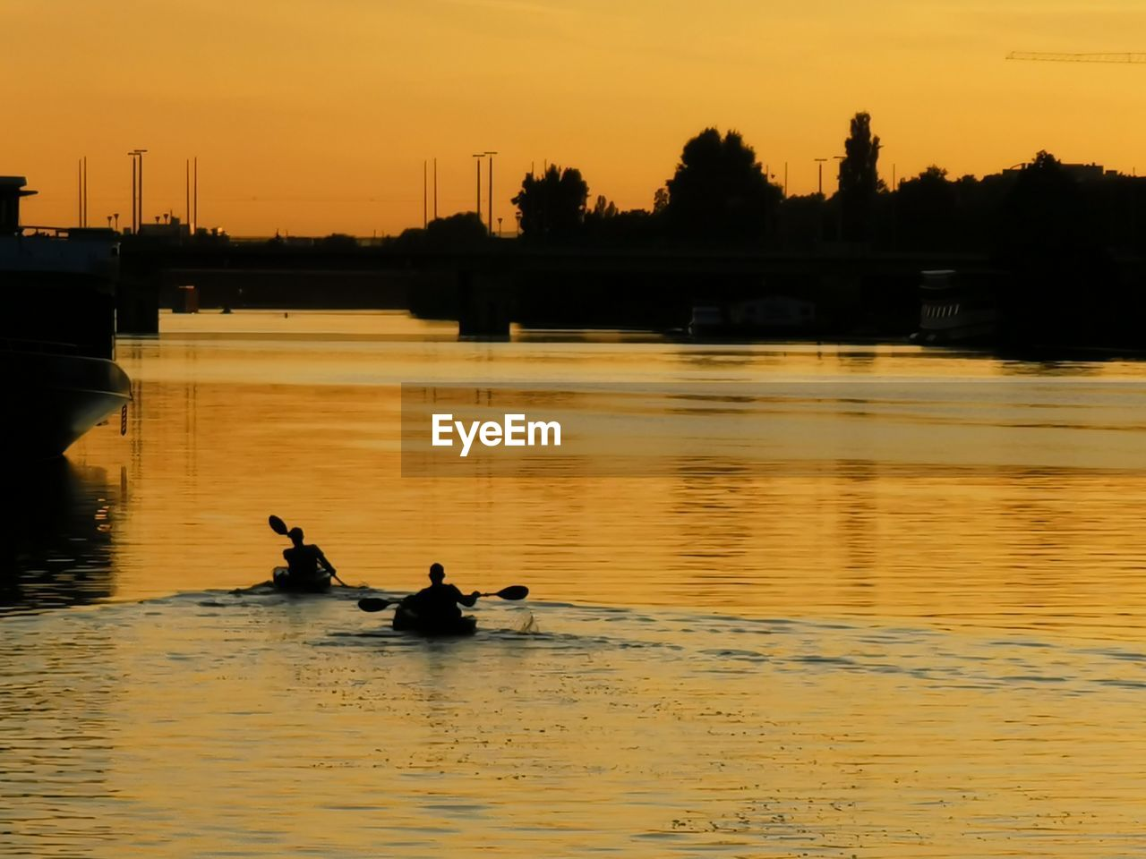 water, sunset, waterfront, nautical vessel, sky, silhouette, orange color, reflection, transportation, real people, river, mode of transportation, beauty in nature, nature, rowing, outdoors, scenics - nature, men