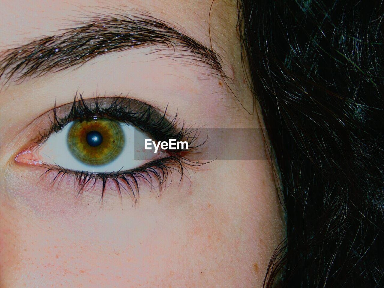 human eye, human body part, eyelash, eyeball, eyesight, one person, human skin, close-up, real people, eyebrow, iris - eye, sensory perception, looking at camera, portrait, outdoors, day, people