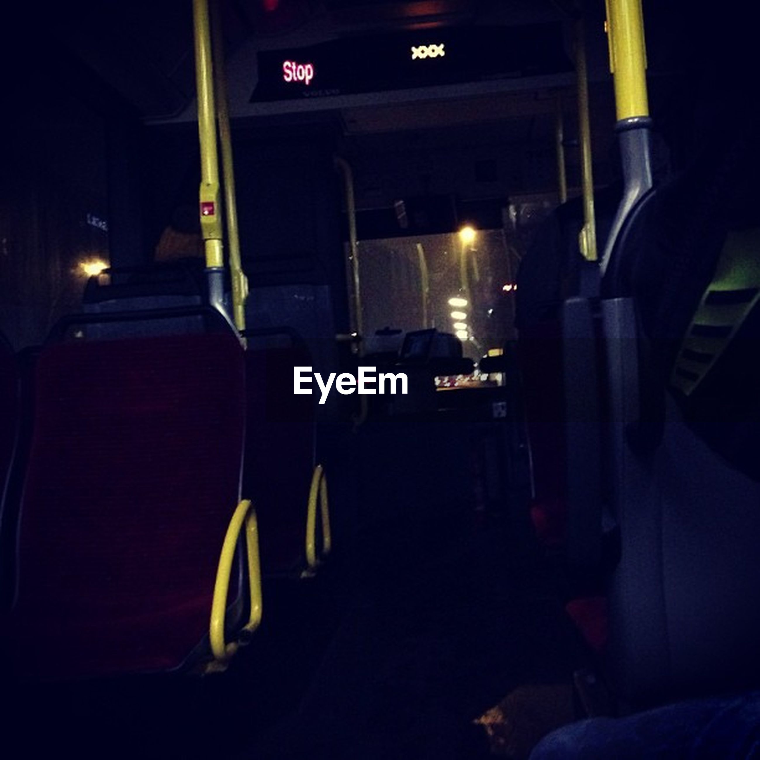 indoors, illuminated, transportation, night, absence, empty, in a row, dark, mode of transport, land vehicle, car, built structure, chair, seat, no people, the way forward, architecture, bus, lighting equipment, incidental people