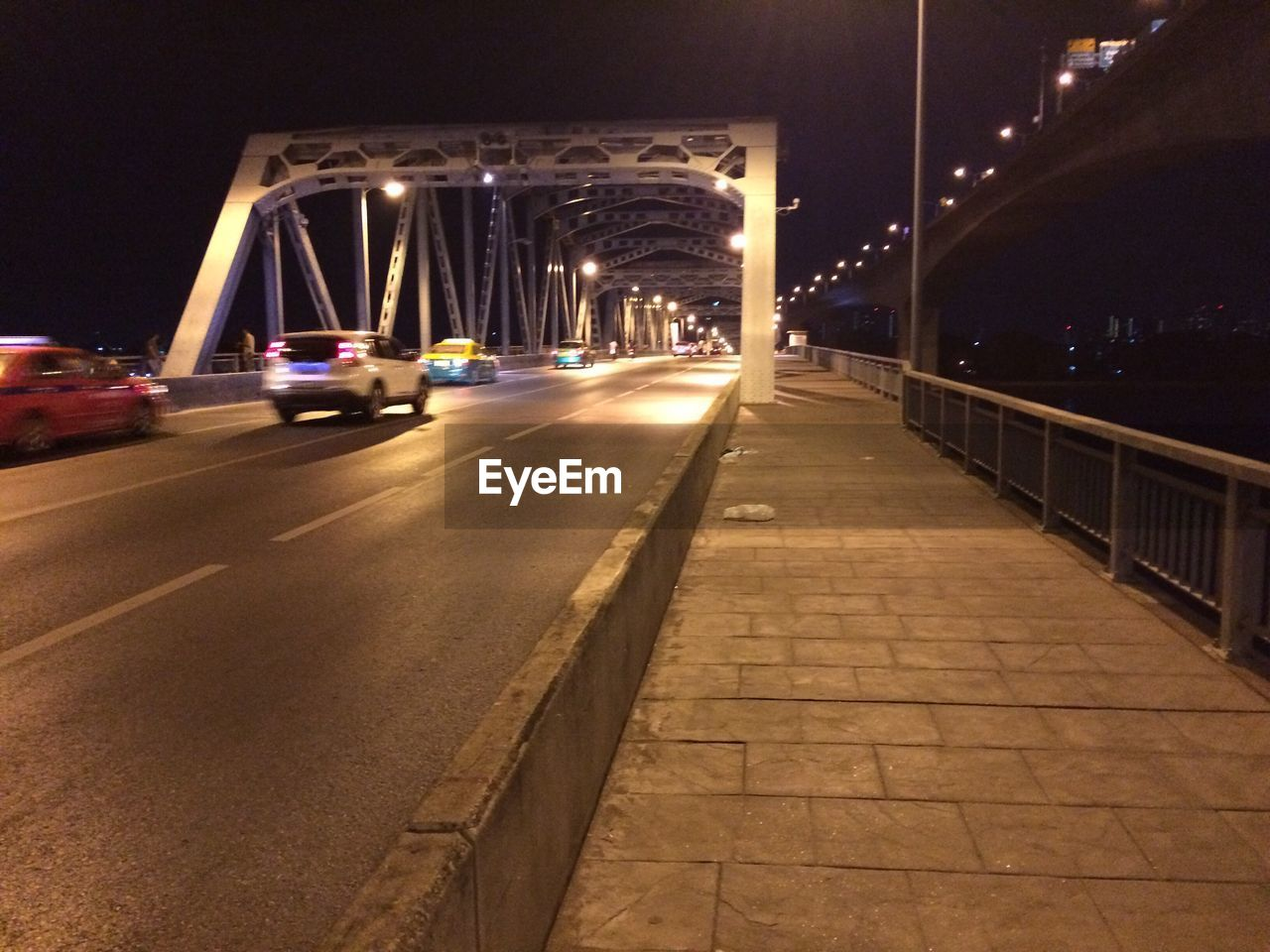 illuminated, night, bridge - man made structure, transportation, connection, architecture, built structure, road, the way forward, street light, city, outdoors, no people, building exterior, sky