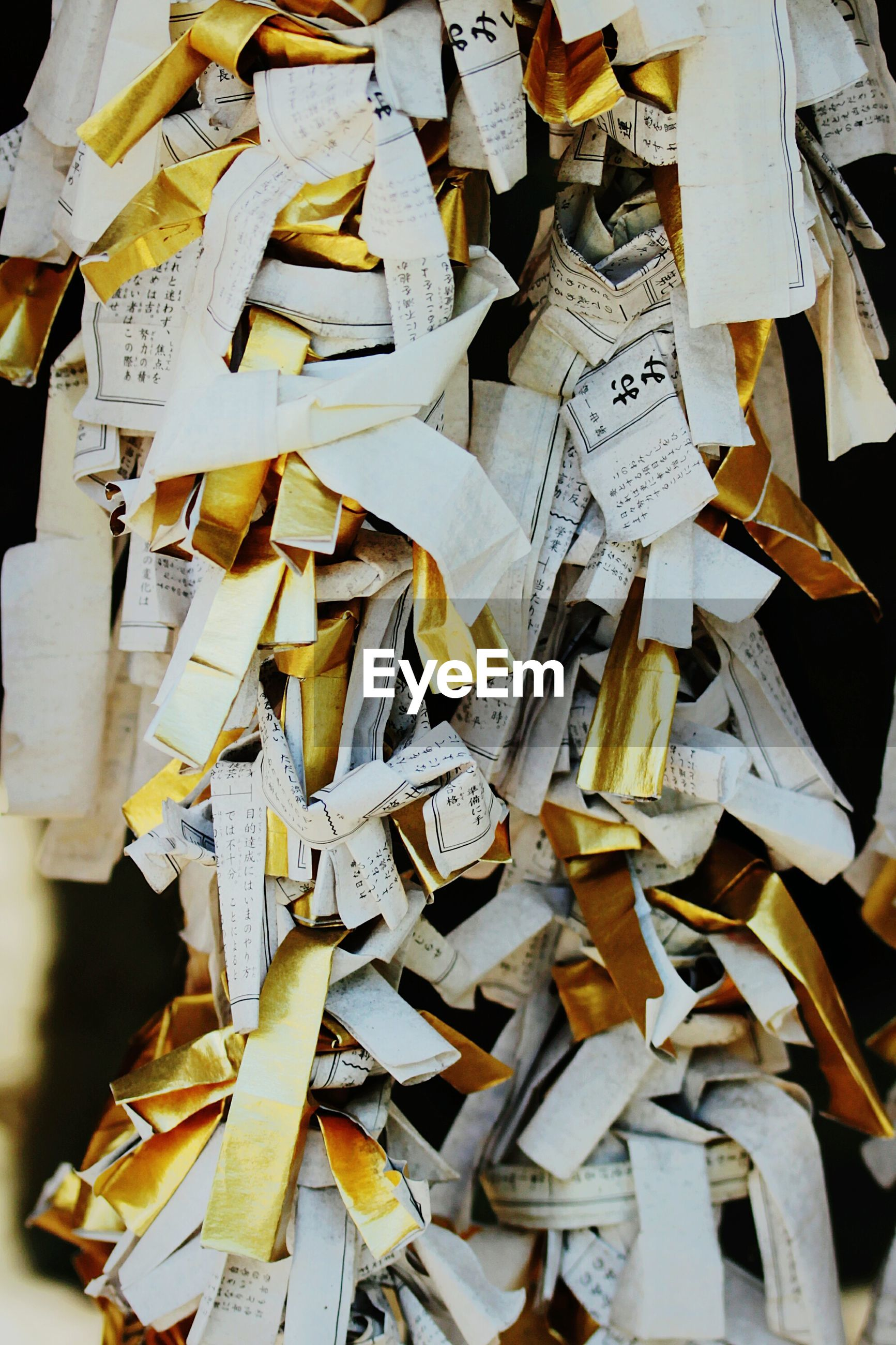Close-up of padlocks hanging on paper