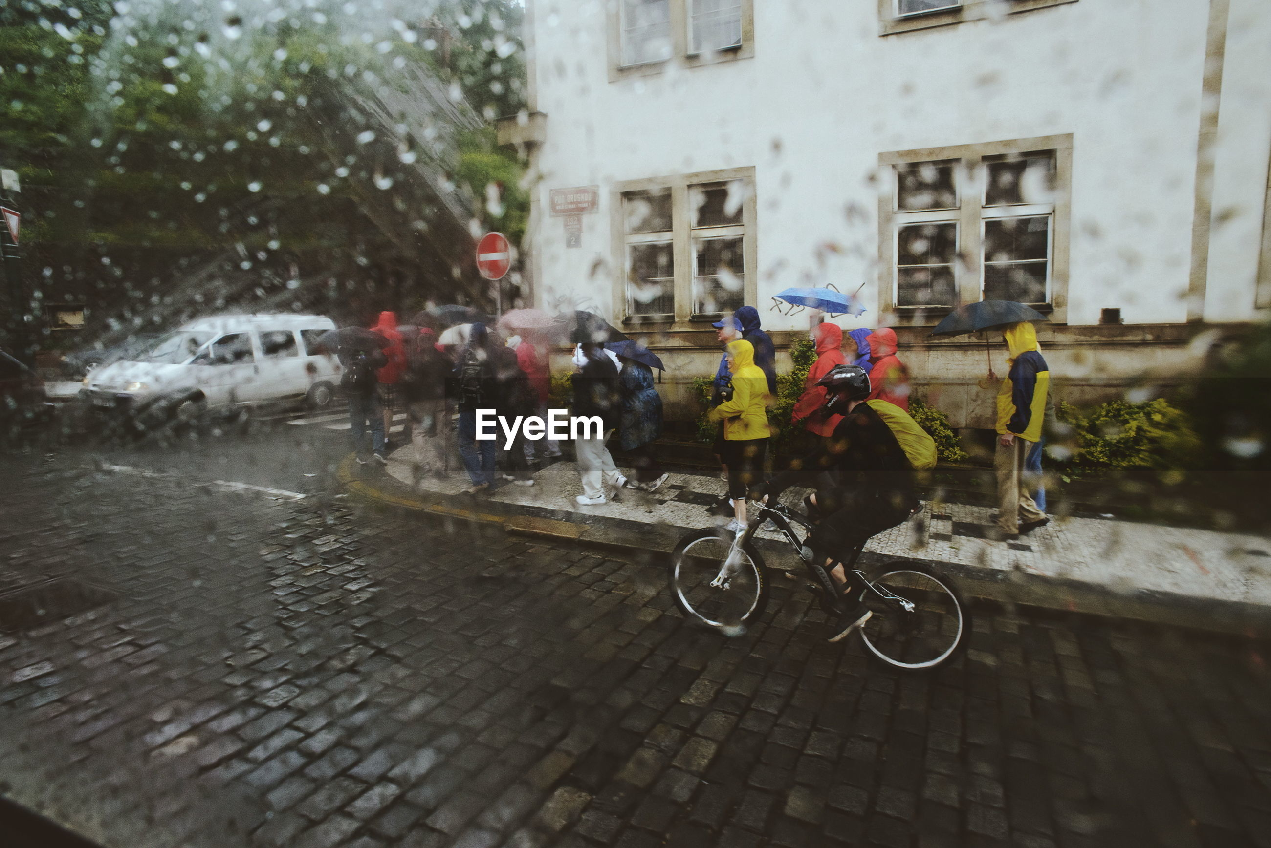 BICYCLE ON WET STREET IN CITY