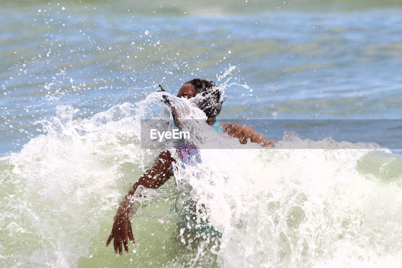 splashing, water, motion, real people, one person, sea, outdoors, leisure activity, lifestyles, waterfront, wave, nature, day, fun, boys, beauty in nature, jet boat, people