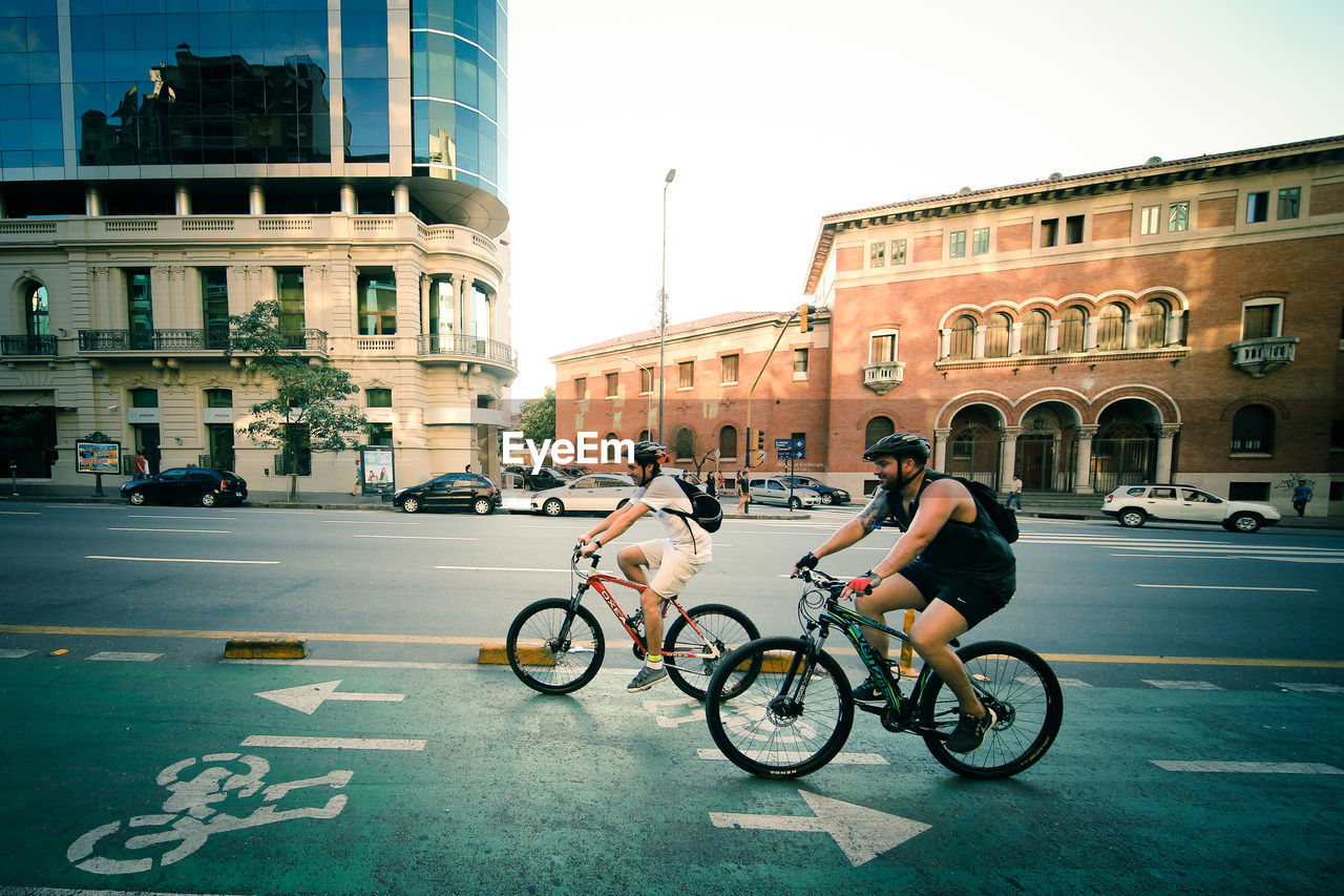 architecture, city, bicycle, building exterior, built structure, street, transportation, outdoors, day, sky, no people
