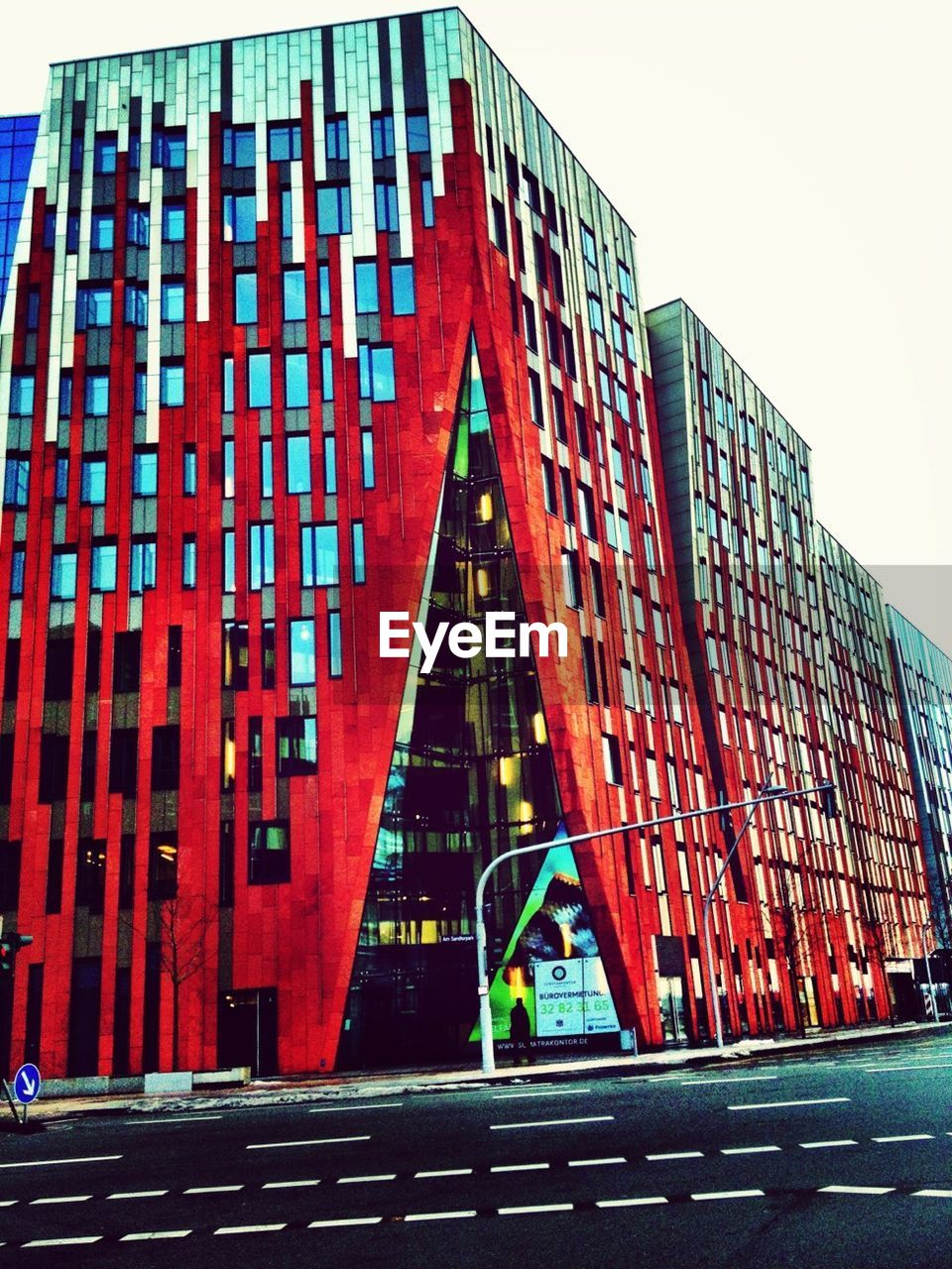 architecture, red, built structure, building exterior, outdoors, low angle view, city, modern, day, clear sky, no people, sky