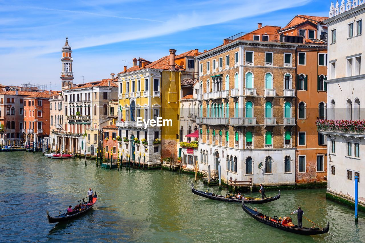 building exterior, architecture, built structure, nautical vessel, transportation, mode of transportation, water, canal, city, building, gondola - traditional boat, travel destinations, travel, tourism, nature, waterfront, residential district, gondolier, group of people, outdoors