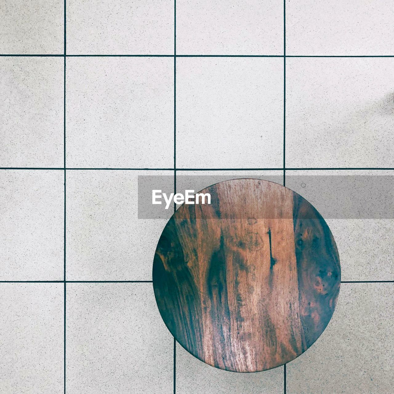 Directly Above Shot Of Table On Tiled Floor
