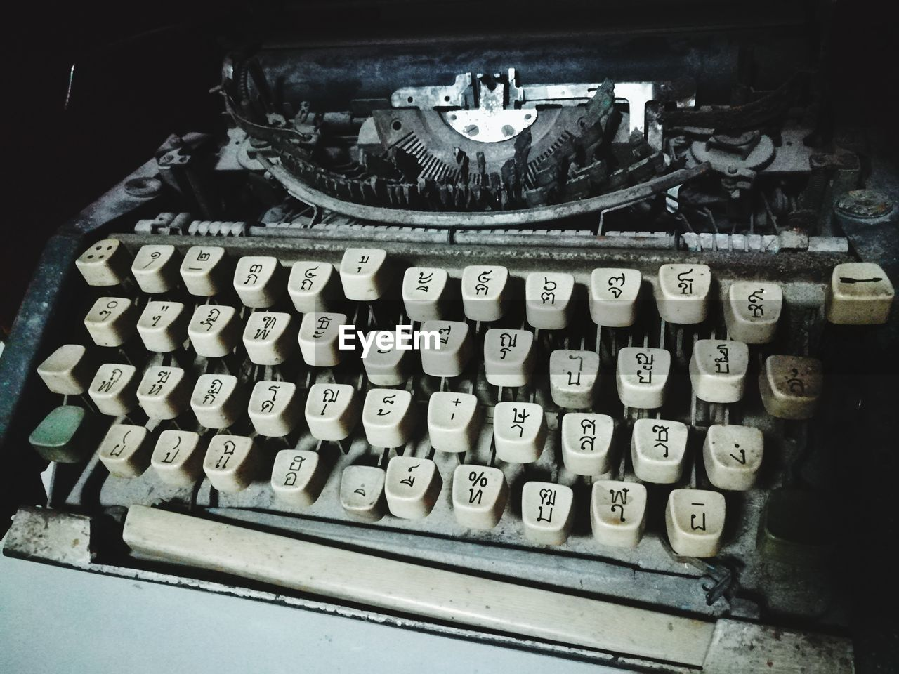 typewriter, retro styled, technology, communication, indoors, antique, old, machinery, letter, close-up, text, no people, alphabet, high angle view, number, still life, machine part, analog, obsolete, keyboard, computer key