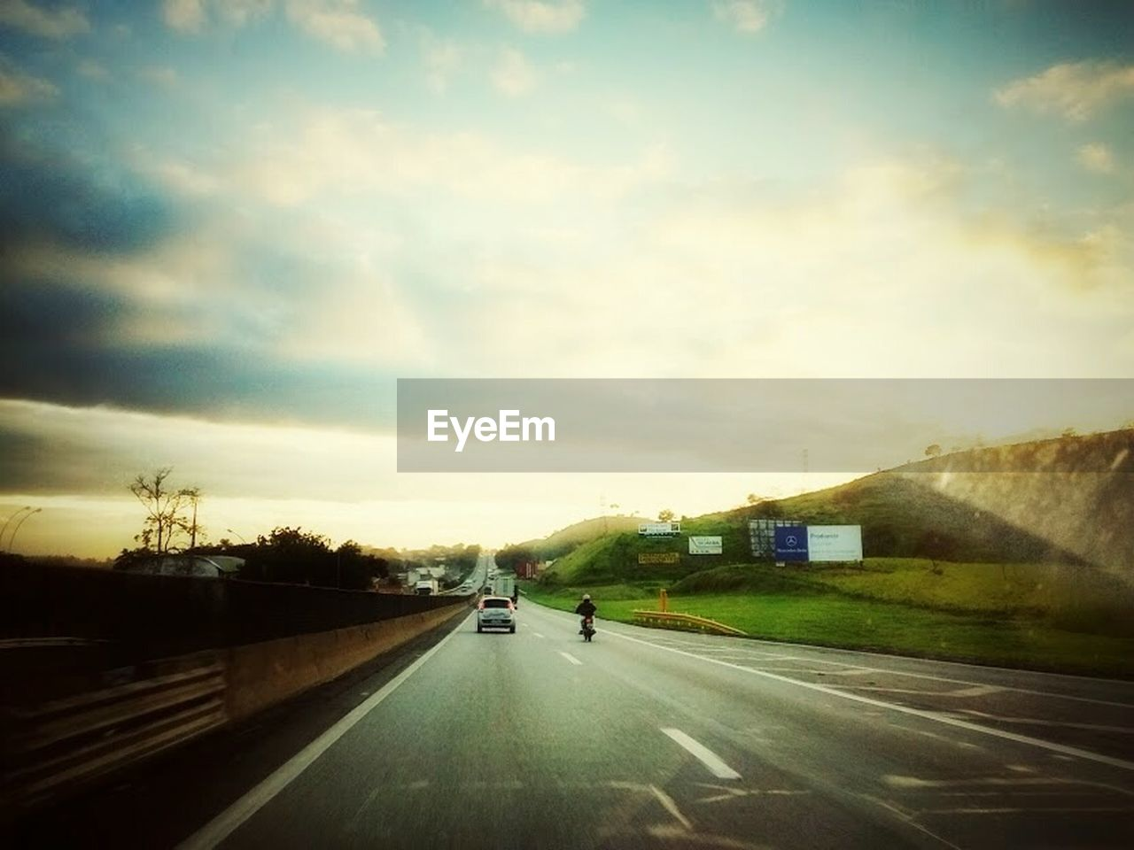 road, transportation, the way forward, street, highway, car, sky, land vehicle, dividing line, outdoors, cloud - sky, day, tree, men, nature, one person, people
