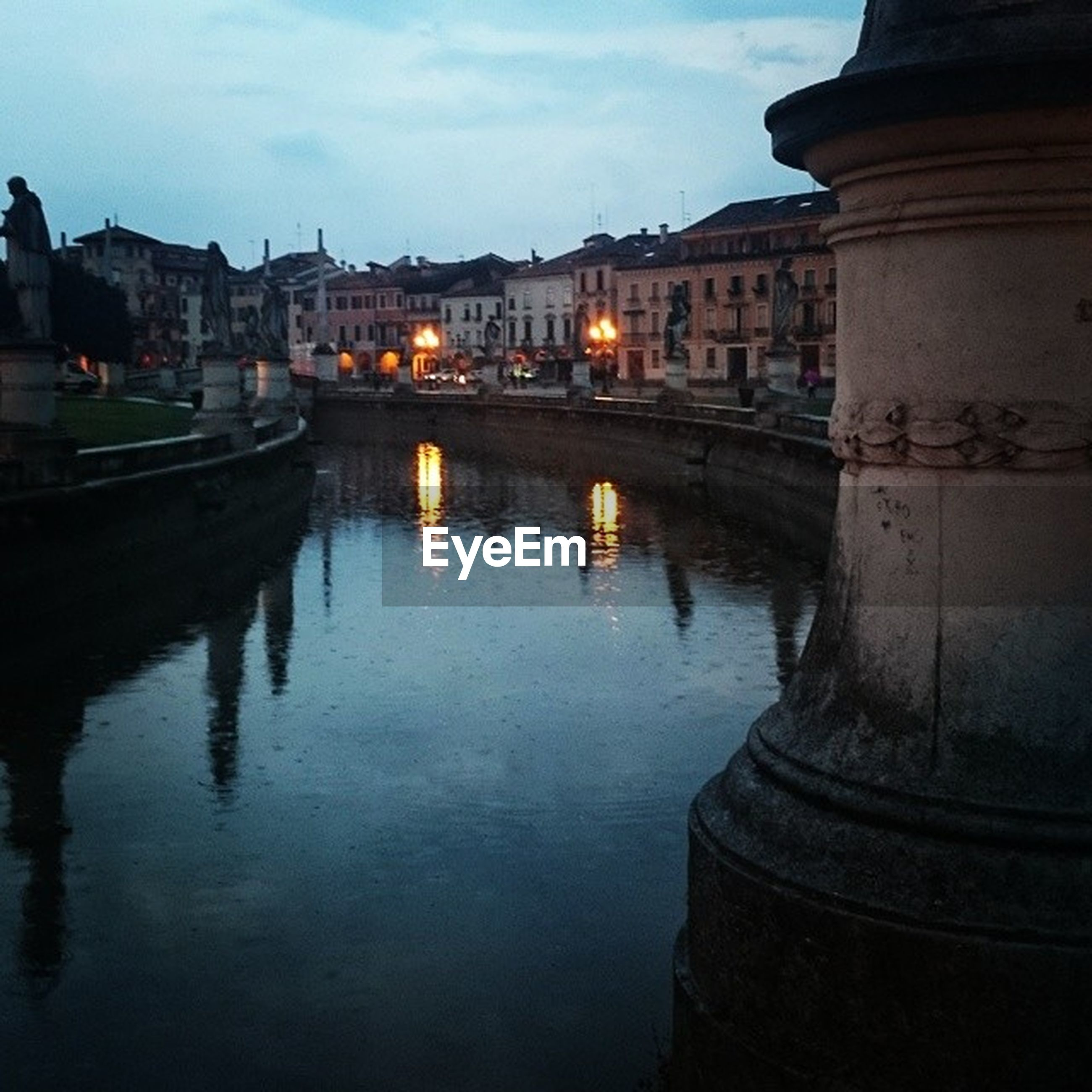 architecture, built structure, building exterior, water, reflection, river, waterfront, canal, city, sky, bridge - man made structure, connection, arch, building, residential structure, transportation, residential building, arch bridge, outdoors, travel destinations