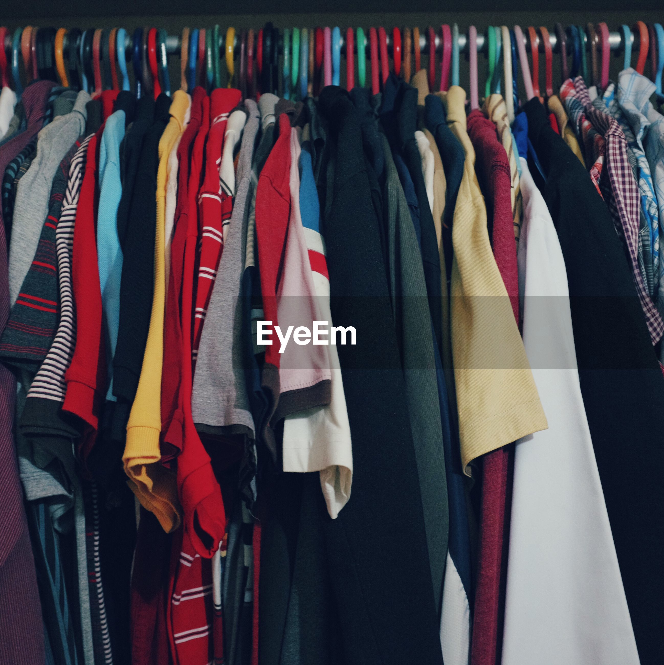 Full frame shot of colorful clothes hanging on rack